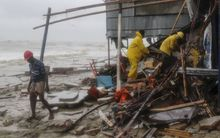 Bangladeshi rescue workers search for survivors after Cyclone Roanu hit the southern Chittagong district.