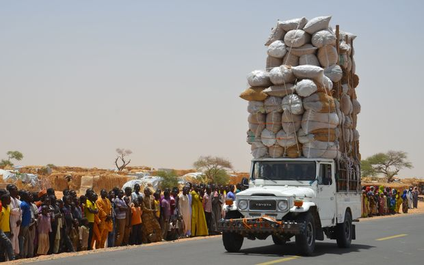 An overloaded car travels through Assaga refugee camp in Diffa on May 17, 2016, close to the Niger-Nigeria border.