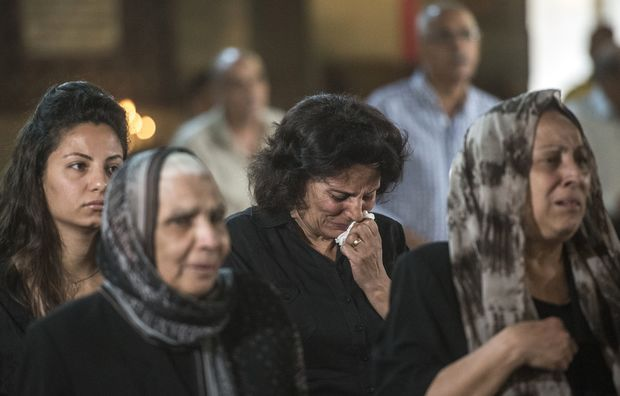 Relatives and friends of the cabin crew and passengers, who were on board the EgyptAir plane that crashed in the Mediterranean, attend a mourning ceremony on May 22, 2016 at the Saint Peter and Saint Paul Coptic Orthodox Church in the Abbasiya district of the Egyptian capital Cairo.