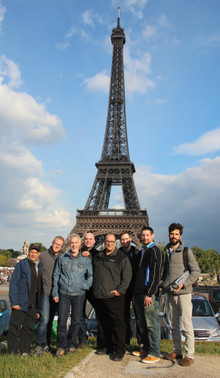 Joseph Bertolozzi with musicians in front of the Eiffel Tower