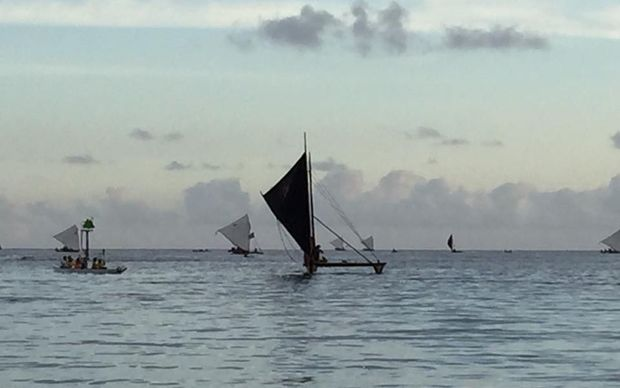 A series of canoes arrive in Guam for the opening day of the Festival of the Pacific Arts.