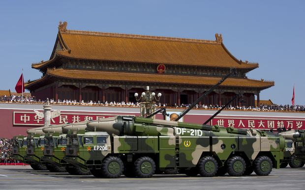 Military vehicles carrying Chinese ballistic missiles in a Beijing parade. China's new generation missiles are capable of reaching Guam and the Northern Marianas, US territories.