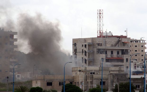 Smoke can be seen from one of three bombs in Tartous on the coast of Syria. Four locations in the city of Jableh, further north, were also bombed.