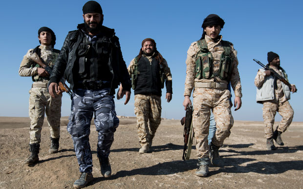 At the front line in the near of Ash Shaddadah in the East of Syria a fighter of the Sunni Sannadid unit from the Al Shammar tribe which is a part of the SDF (Syrian Democratic Forces) who is fighting the Islamic State