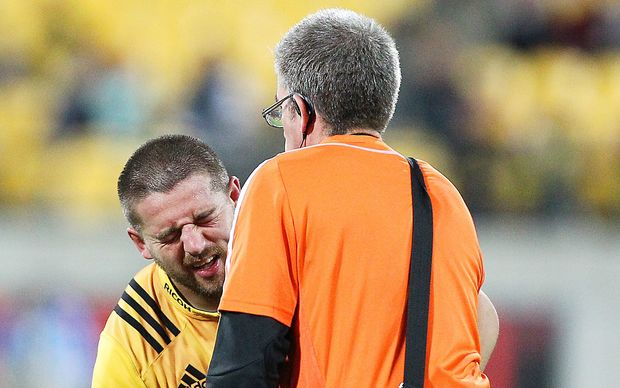 Hurricanes captain Dane Coles receives treatment.