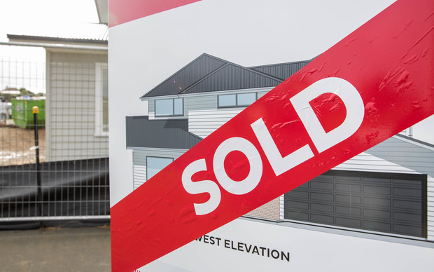 Sold sign outside a new house being built in East Auckland