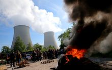 Workers block the access to the nuclear power plant of Nogent-sur-Seine with a barricade of fire.