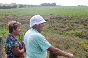 BEFORE  John and Geraldine Taylor survey the 1 75 hectares area along the river the next piece to be replanted