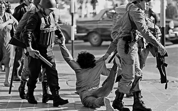 Picture taken 30 March 1982 of a worker who is being arrested during a protest against Argentine dictatorship (1976-1983) in Buenos Aires.