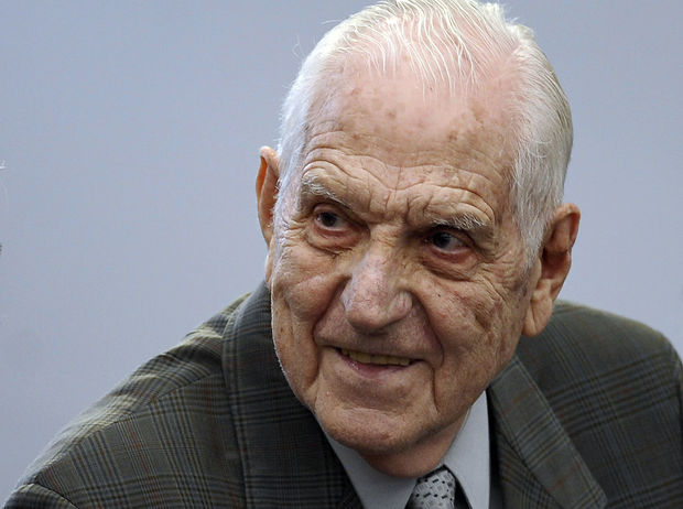 Last Argentine dictator (1982-1983) and Army chief Reynaldo Bignone smiles at the courtroom before being sentenced during his trial, in Munro, Buenos Aires on April 20, 2010.