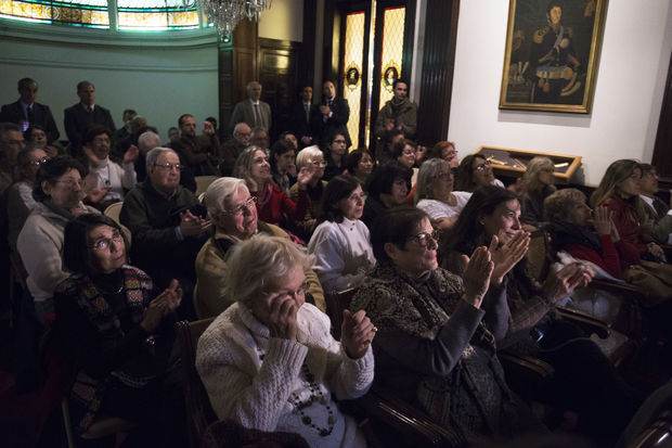 Relatives and victims of Argentine and Uruguayan military dictatorships react as they hear the sentence of Argentina's court in the trial on Operation Condor, at the Argentina's embassy in Montevideo on May 27, 2016.