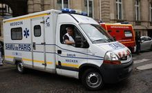 An ambulance leaves a building requisitioned to treat injured people, near the site of the accident at Parc Monceau in Paris.