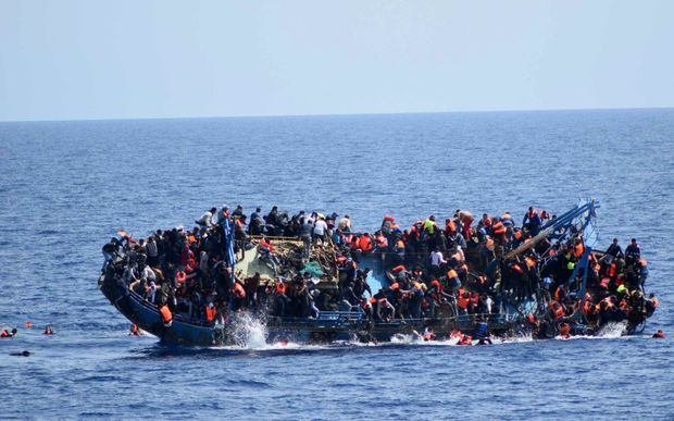 An image released by the Italian Navy shows the shipwreck of an overcrowded boat of migrants off the Libyan coast.