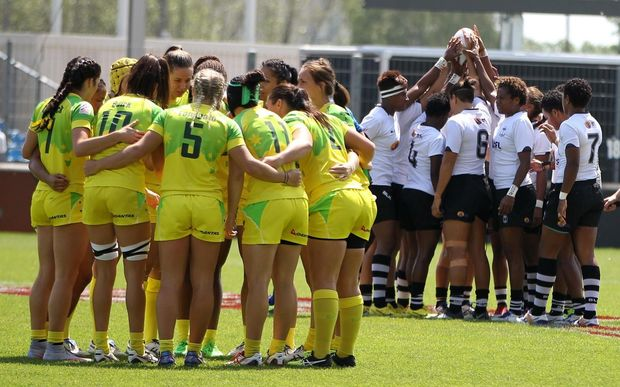 Australia and Fiji huddle before their clash at the Clermont-Ferrand Sevens.