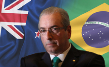 Eduardo Cunha infront of a NZ and Brazilian flag