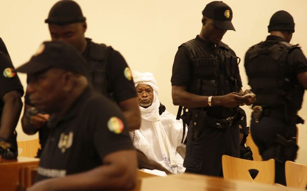 Hissene Habre is escorted in to stand trial at the Palais de Justice in Dakar, Senegal, Monday on July 20, 2015.