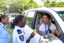 Solomon Islands Police officer about to administer a passive alcohol breath test.
