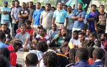UPNG students meet on campus.