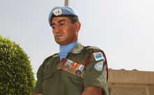 A Fijian UN peacekeepers perform an honour guard at the UN headquarters in Baghdad's Green Zone on August 13, 2008, during a ceremony commemorating the fifth anniversary of a massive bomb attack on August 19, 2003.