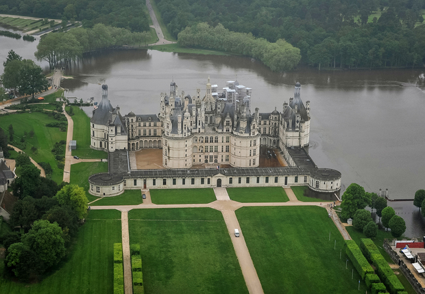 Chambord castle, a UNESCO world heritage site, surrounded by water.