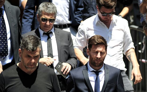 Lionel Messi (front right) and his father Jorge Horacio Messi (back left) leaving court.