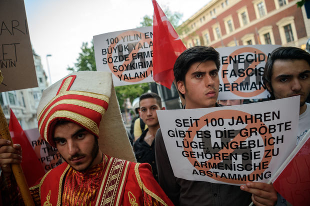 "Turkish nationalist protesters wearing Ottoman clothes shout slogans against Germany and hold placards reading ""the biggest lie in 100 years is the Armenian genocide"" during a protest against Germany on June 2, 2016 in front of the Germany consulate in Istanbul"