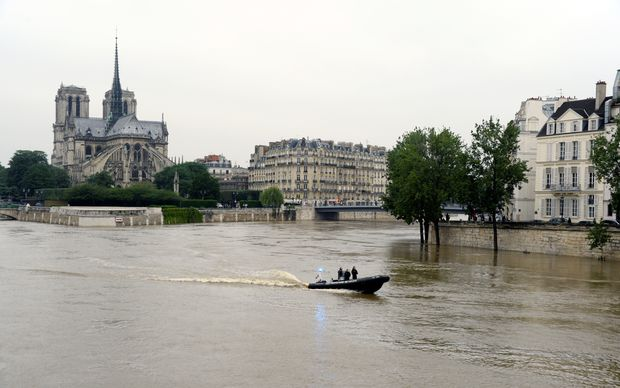 Flooded banks of the river Seine in Paris, as torrential downpours and flooding lashes parts of northern Europe leaving at least 15 dead.