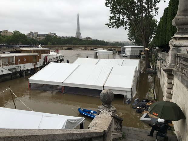 The scene near Pont Alexandre III on the Seine,where the rising waters have inundated riverside businesses.
