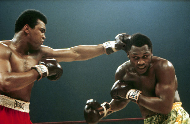 Muhammed Ali (Cassius Clay) punches Joe Frazier during their boxing match, 1971.