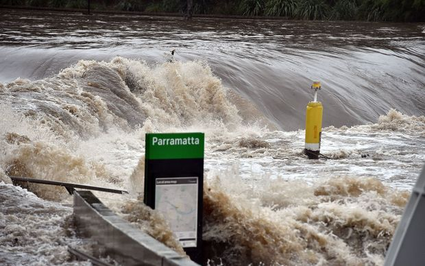 A ferry terminal is submerged by the overflowing Parramatta river in Sydney.