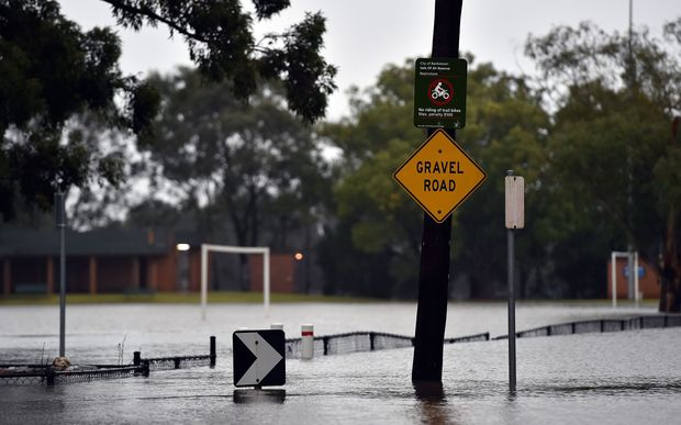 Floodwaters submerge a road after the Georges River burst its banks in Sydney.