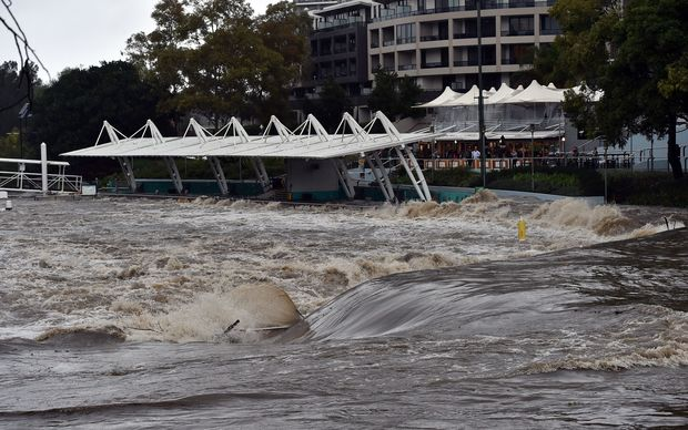 A ferry terminal is submerged by the overflowing Parramatta river in Sydney on Sunday 5 June 2016.