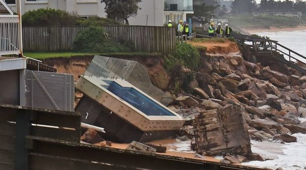 An inground pool sits amongst the rocks after a severe storm at Collaroy on Sydney's northern beaches.