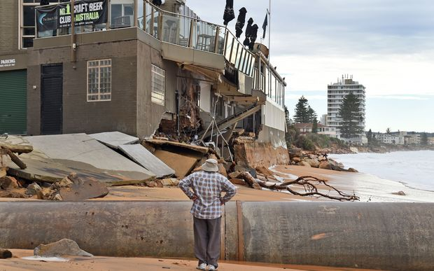 A man locals at the damage caused by a severe storm at Collaroy on Sydney's northern beaches.