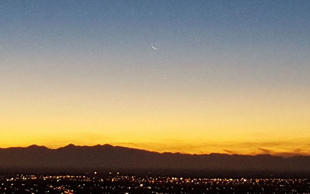 The waning crescent moon rising over Christchurch signals the beginning of Ramadan.