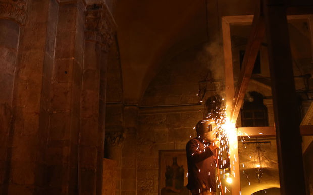 Restorations have begun on the ancient tomb in Jerusalem where Christians believe Jesus was buried - the most extensive works in more than two hundred years.