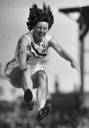 Yvette Williams in an attempt to break her own long jump world record in Dunedin during a visit of Queen Elizabeth II and Philip, Duke of Edinburgh
