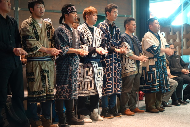 Members of the Ainu delegation perform during the powhiri to welcome them in Taranaki.