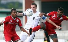 All Whites captain Chris Wood battles for posession in the OFC Nations Cup semi-final against New Caledonia.