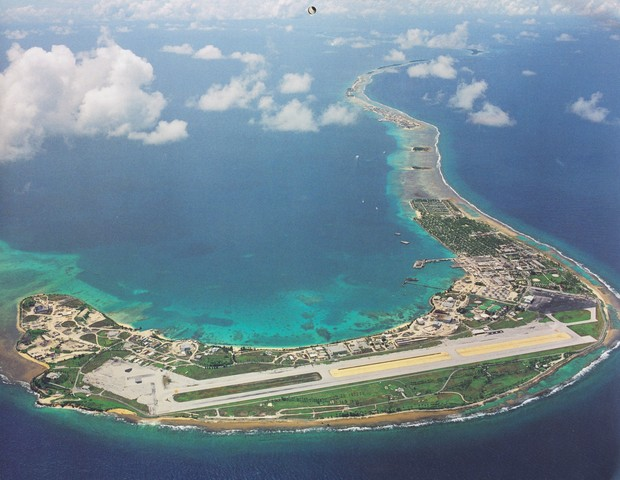 Aerial view of the main island in Kwajalein Atoll, which is the headquarters for the U.S. Army's Reagan Test Site, an important missile defense facility. Fish in the lagoon area of the base have been found to have high levels of chemical contamination.