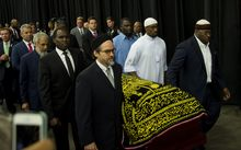 Pallbearers escort the casket of boxing legend Muhammad Ali during the Jenazah prayer service at Freedom Hall in Louisville, Kentucky.