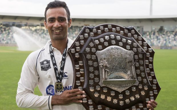 Auckland batsman Jeet Raval with the Plunket Shield.