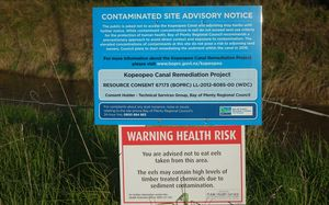 Sign warning of health risk due to chemicals and advising against  collecting eels etc