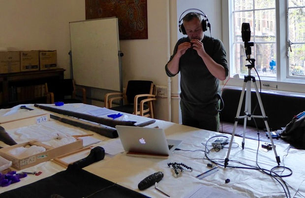Alistair Fraser playing the tango pūoro collection at CambridgeUniversity Museum of Archaeology and Anthropology.