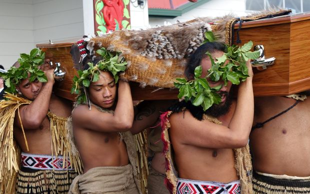 Sir Graham's coffin is carried from the marae.