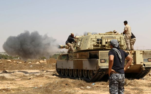 Libyan unity government forces fire from a tank in Sirte towards Ouagadougou.