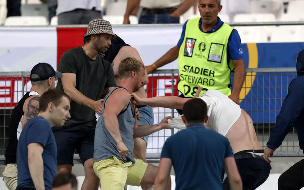 Supporters fight at the end of the Euro 2016 group B football match between England and Russia at the Stade Velodrome in Marseille on June 11, 2016.