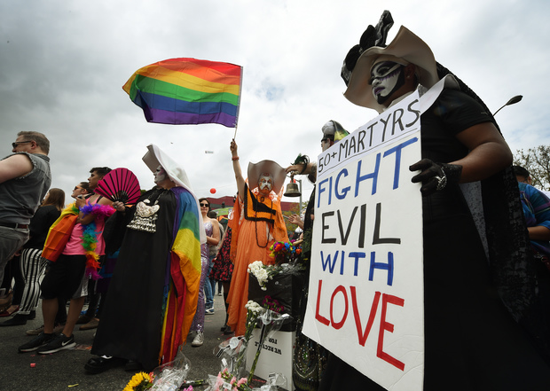 Participants show their support for victims of the Orlando shooting during the 2016 Gay Pride Parade on June 12, 20116 in Los Angeles, California. Security for the tightened in the aftermath of the deadly shootings June 12 at the Pulse, a packed gay nightclub in Orlando, Florida.