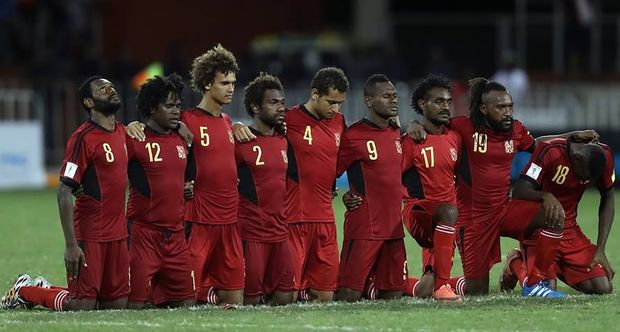 PNG players on edge during the penalty shootout.