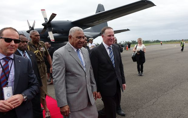 New Zealand Prime Minister John Key and Fiji Prime Minister Frank Bainimarama meet at Suva Airport.